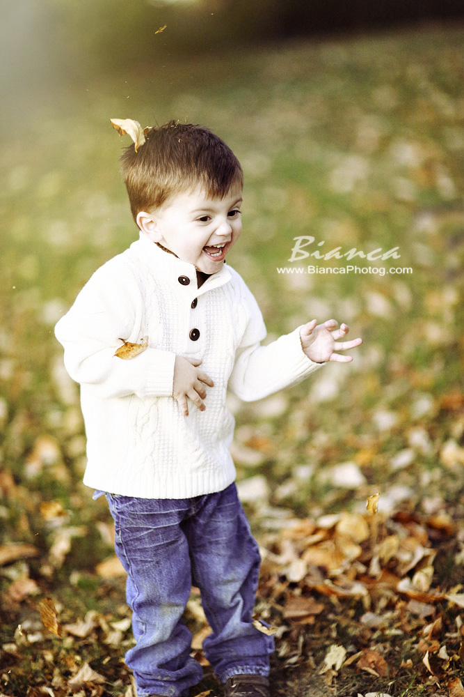 Young boy laughing in the fall