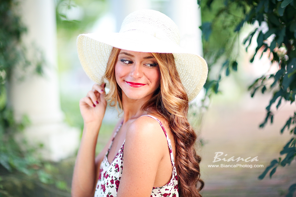 Senior girl in sundress and white hat