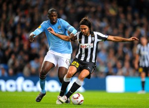 Juventus's Jorge Martinez (right) and Manchester City's Gnegneri Toure Yaya battle for the ball