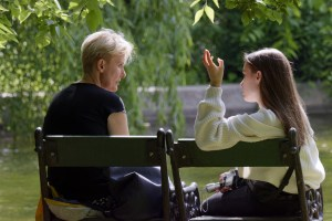 A woman and a teen conversing as an example of organic and informal church discipline