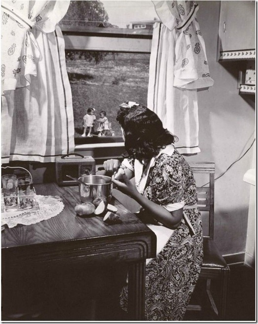 1942 Anacostia Mother watching her kids while preparing dinner, Wash DC - Gordon Parks