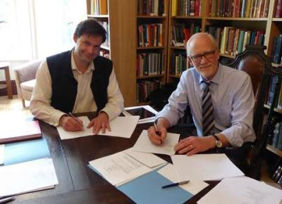 Licence signing between Crossway with Cambridge University Pres