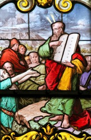 STOCKHOLM SWEDEN - APRIL 16 2010: Stained glass window depicting Moses with the Stone Tablets in Saint James's Church in Stockholm Sweden.
