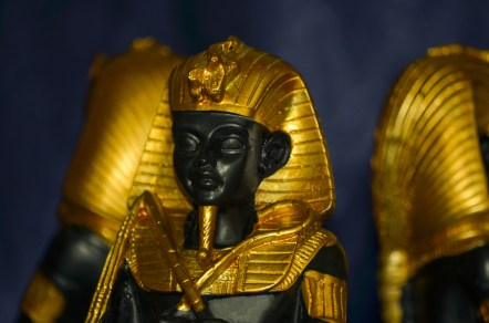 Golden ancient egyptian pharaohs statuette with blurred effect