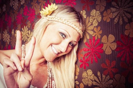 Beautiful hippie peace sign girl
