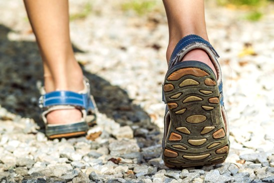 Close-up Of Sport Shoes On Trail Walking In Mountains On Stones,
