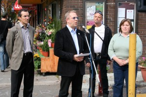 Sean addressing press with Peter Ladner, Nash & Laura McDiarmid