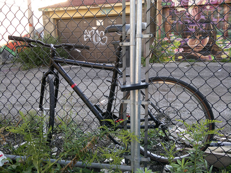 The StayLocked Bicycle locked to a fence.