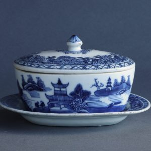 A Chinese export porcelain blue and white covered butter tub on stand