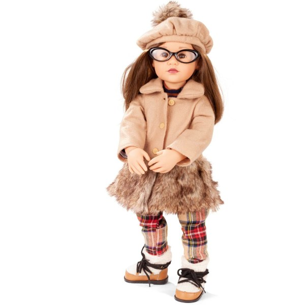 Poupée Happy Kidz Frieda avec un bonnet beige, des lunettes, un manteau beige, une jupe, des chaussettes écossaises et des chaussures