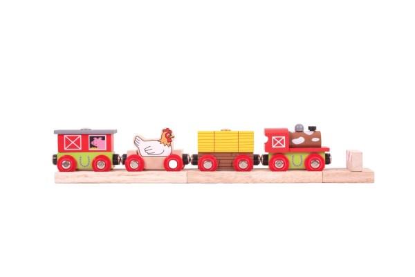 Le train de la ferme en bois est magnétique et a de belles couleurs vives rouge et jaune.
