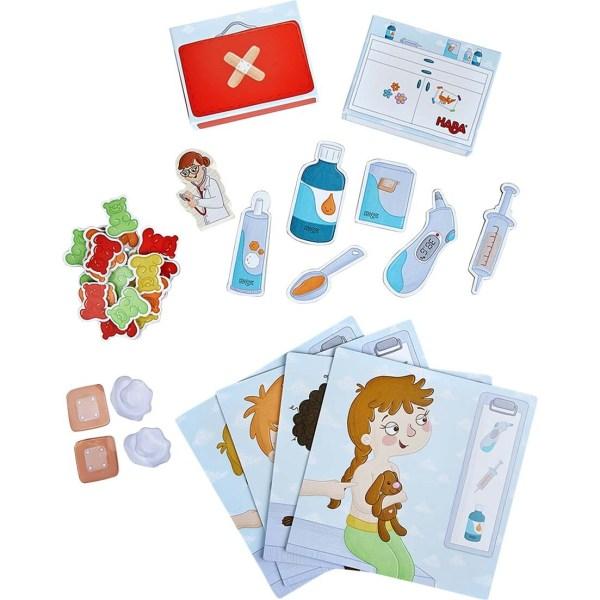 contenu du jeu Carte du jeu Docteur Premiers Bobos avec des cartes patients, les instruments médicaux, les pansements...