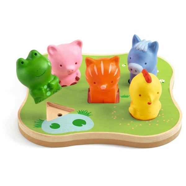 Caconimo le puzzle bruité avec une grenouille verte, un cochon rose, un ane bleu, une poule jaune et un chat orange sur un plateau vert