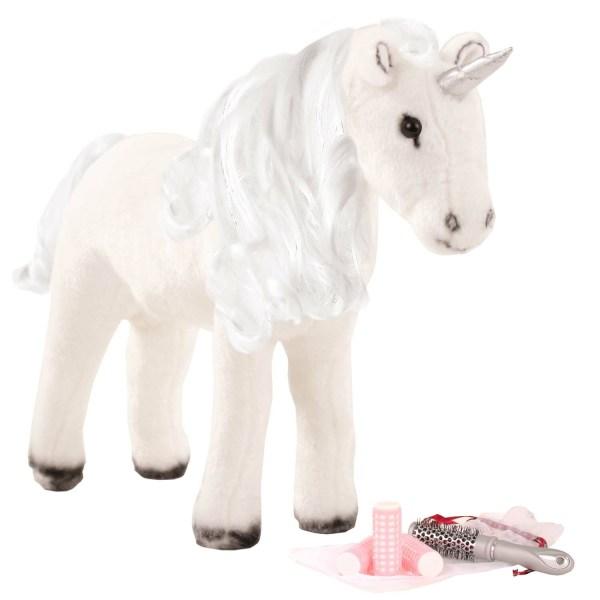 Licorne à coiffer blanche avec une crinière argenté et une corne argenté, il y a une brosse et des bigoudis dans un petit sac