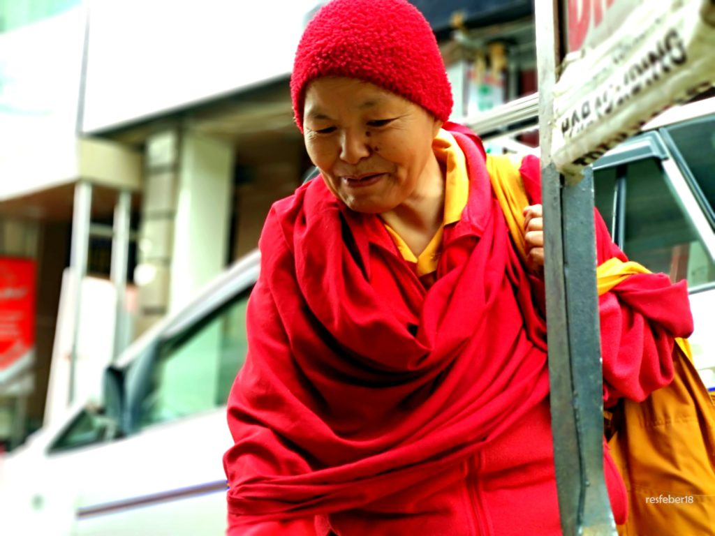 A lady monk in McLeod Ganj