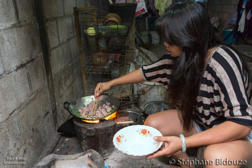 Thai woman cooking khin Khao in the morning