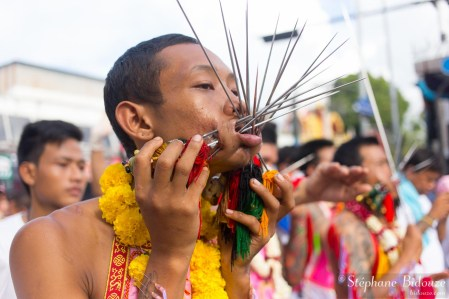 Phuket Town, THAILAND, October 09, 2016 : Devotee extreme piercing street procession during the Taoist vegetarian festival of the Nine Emperor Gods in Phuket, Thailand .