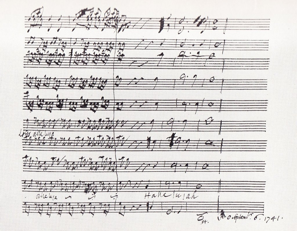"""Photo of the final bars of the """"Hallelujah"""" chorus from Messiah by Handel, from the composer's autograph score."""