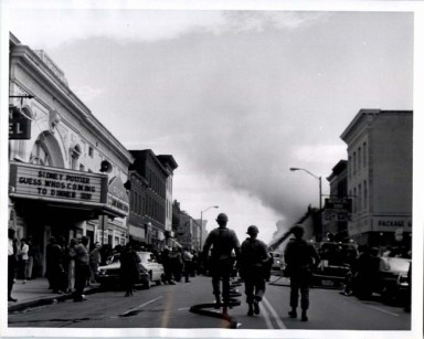 National Guard troops walk down a street during Baltimore's 1968 riots.