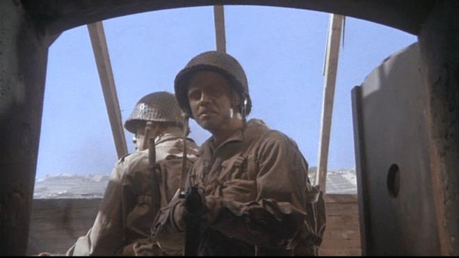 Pvt. Griff (Mark Hamill) before the crematorium oven door.