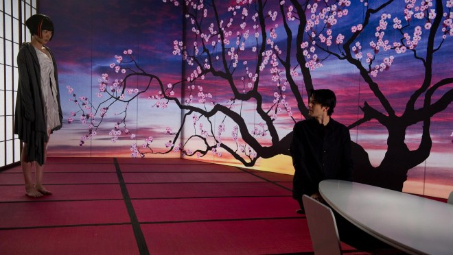 Sonmi-351 (Doona Bae) and Hae-Joo Chang (Jim Sturgess) in Cloud Atlas.