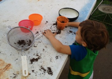Playing with containers and dirt
