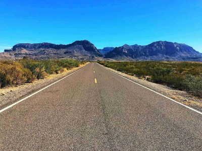 Ross Maxwell scenic drive leading straight towards the chisos mountains and a view of the window right in front
