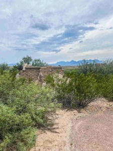 ruins of joe loftin house in big bend with chisos on back ground