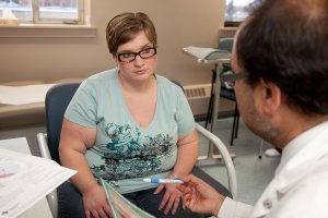 Woman looking unimpressed at the lack of Plus Size Friendly Care she's receiving