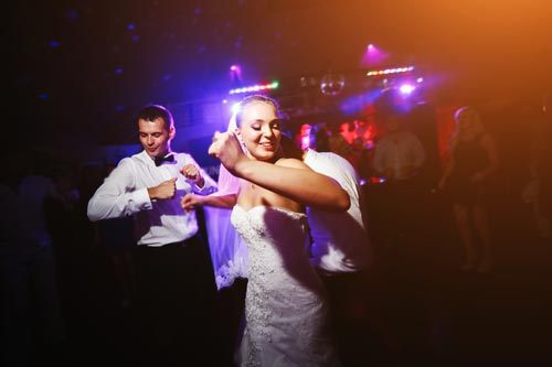 bride dancing with her husband - Wedding Limos