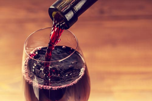 pouring a glass of red wine - Wine Tours