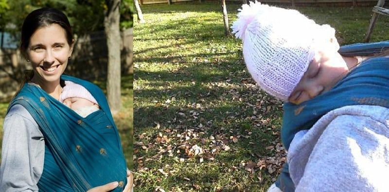 raking leaves while baby wearing