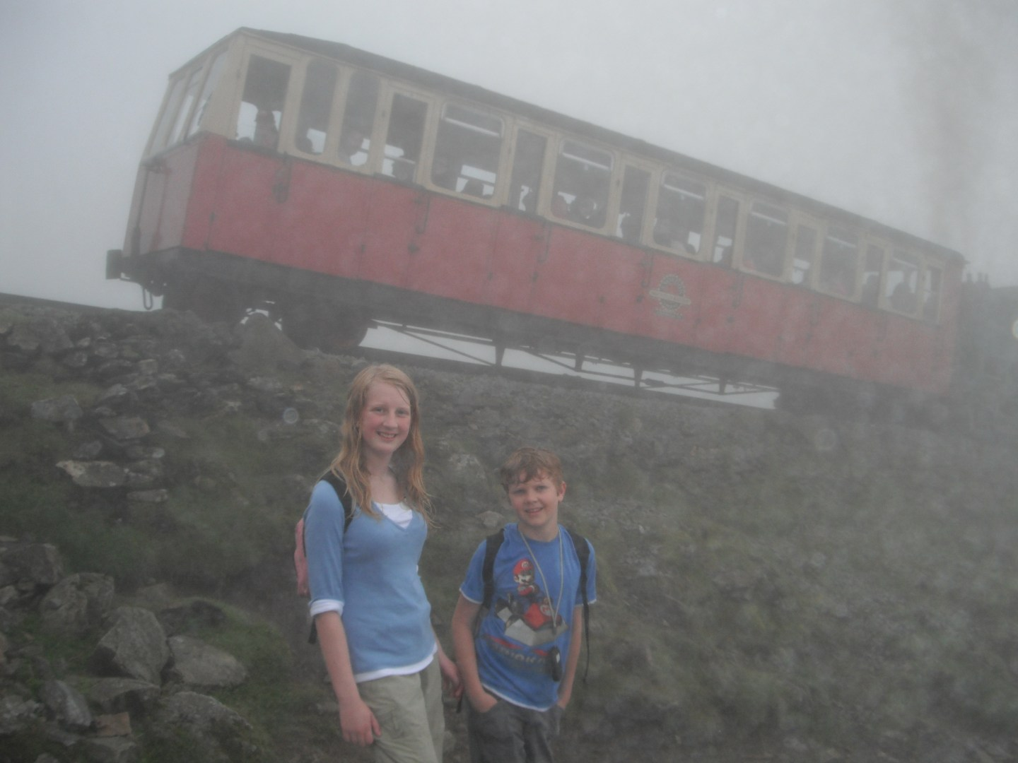 Xene and Lochlan with tyhe Mount Snowdon train in the background