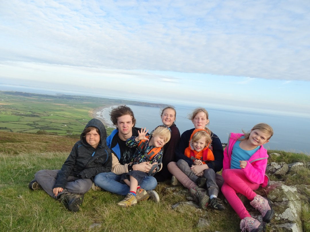 Big Family Little Adventures Kids on top of a mountain in Wales, want to work with this crazy bunch, then contact us