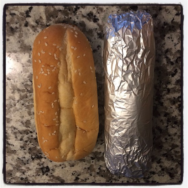 Demonstrating how tightly the sandwich is wrapped