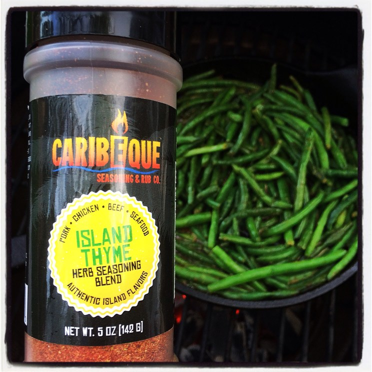 Island Thyme Green Beans in a cast iron skillet on The Big Green Egg