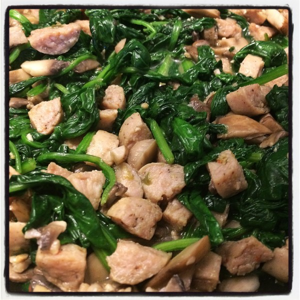 Sautéed mushrooms, chicken sausage, and spinach all set for the pizza