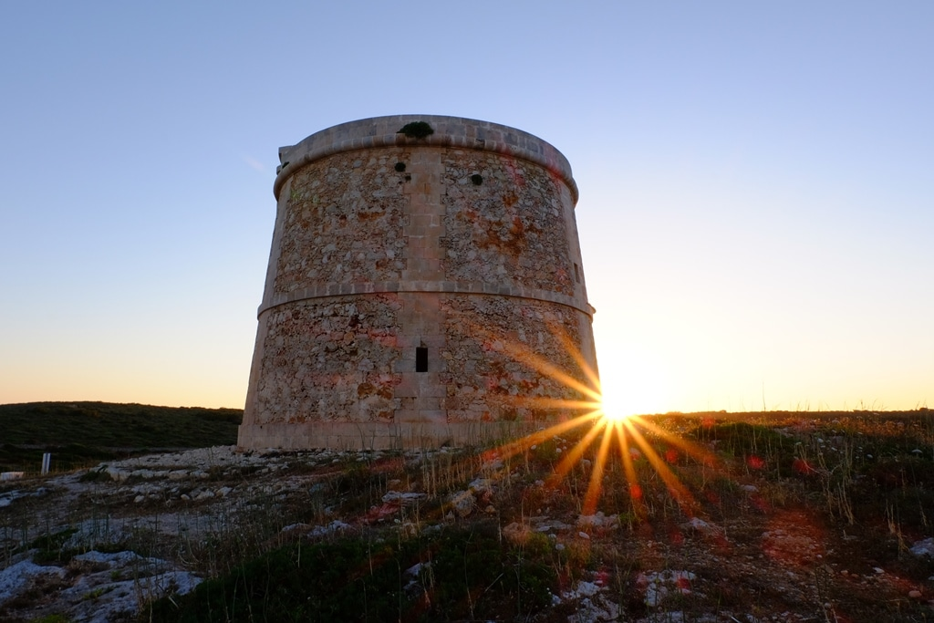 A starburst photography sunset at the Alcaufar tower