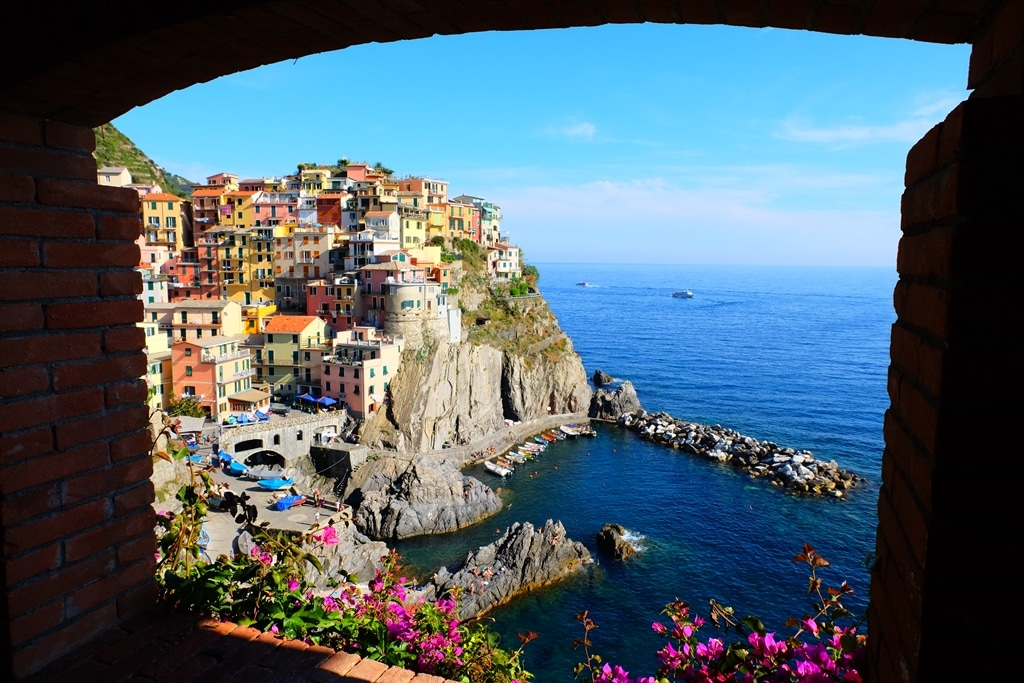 The view of Manarola through some arches by the cemetery