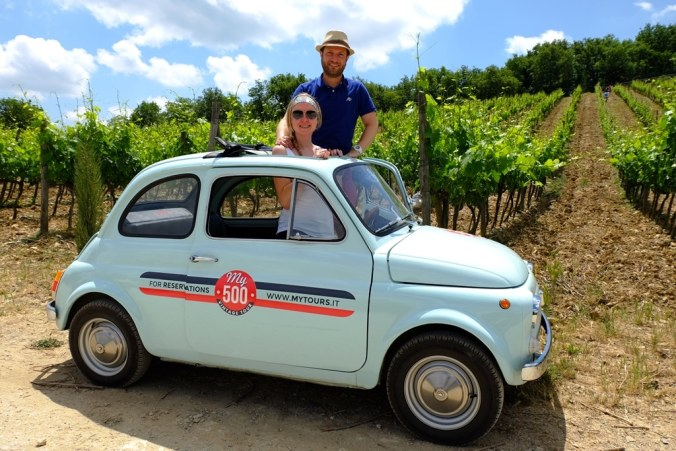 Posing in another one of the Fiat 500s at the Chianti winery