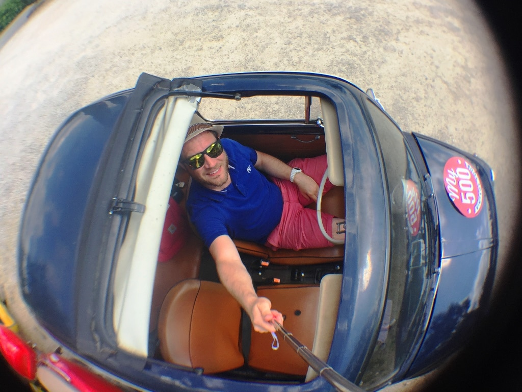 A selfie stick view out of the sunroof