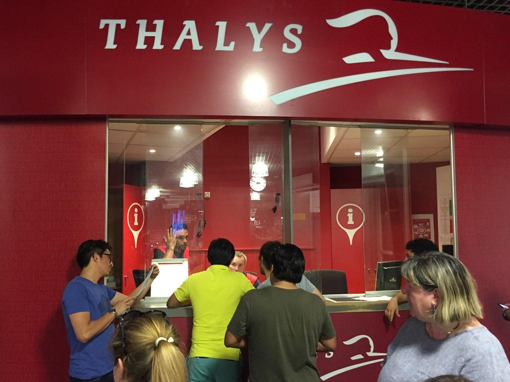 Queuing up at the Thalys desk for our hotel rooms