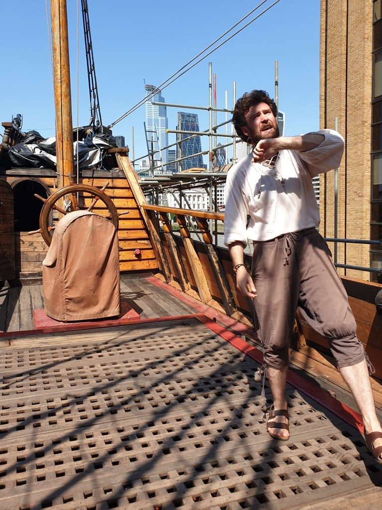 Tour guide on the Golden Hinde deck