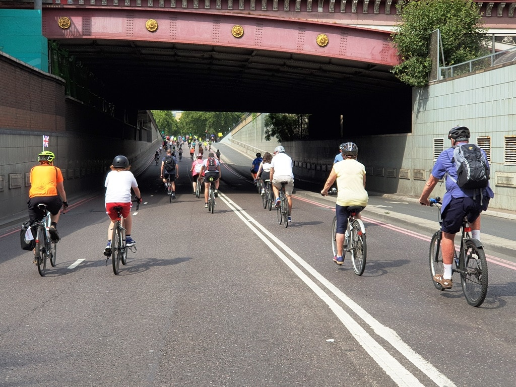 Cyclists riding under the Blackfriar's Underpass