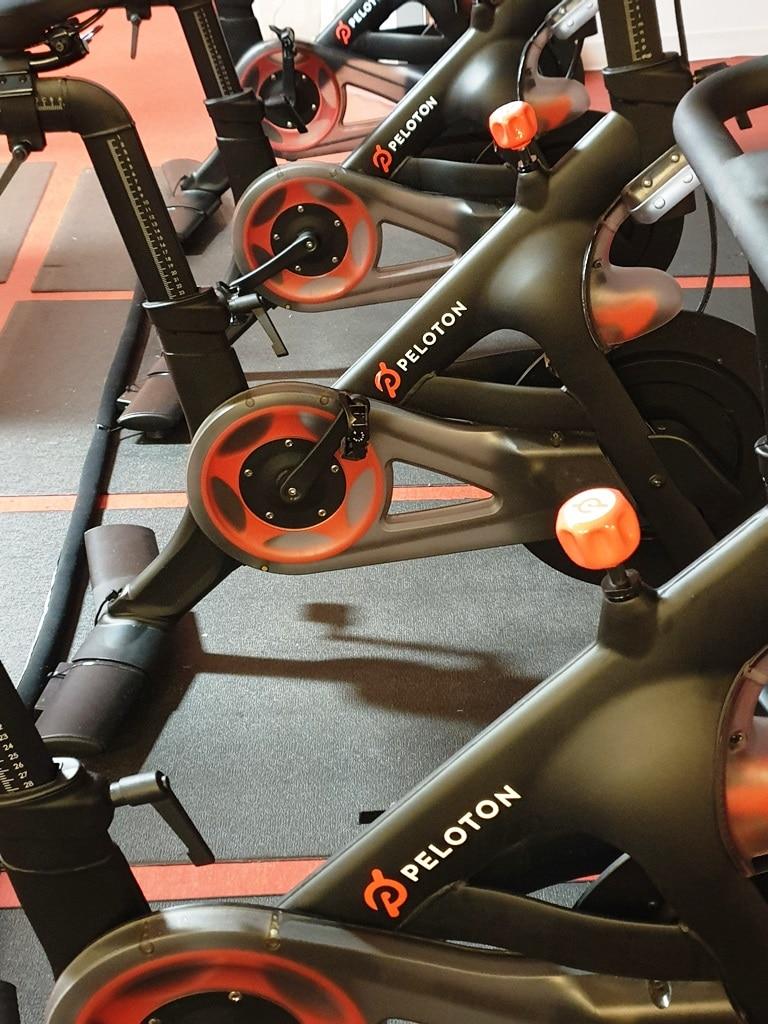 Side on view of 4 Peloton bikes