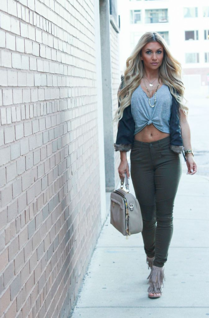 Fall Fashion. Olive biker pants, fur vest and fringe heels.