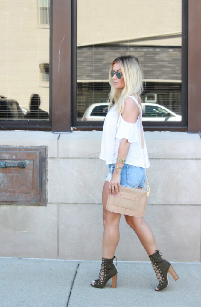 Ripped jean shorts with lace up booties.