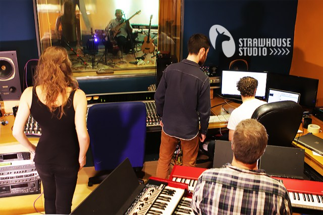 Producers and Artists stood in the control room at Strawhouse Studio