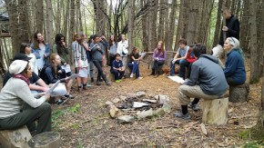 sitting around the fire at borderlands, a fairy walk put on by Way of the Bard, planning our performances