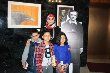 Library Commissioner Arrwa Mogalli and children with Poe
